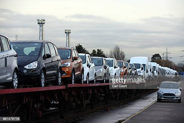 Cars are loaded onto a freight train at a Ford factory on January 13 2015 in Dagenham England Originally opened in 1931 the Ford factory has unveiled...