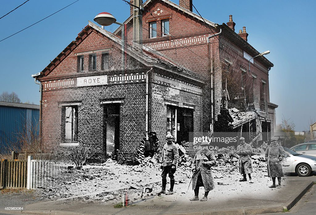 In this composite image a comparison has been made of The former railway station building. Commemorations of The First World War Centenary begin in 2014 and will last until 2018. Cars are parcked at the former railway station on March 12, 2014 in Roye, France. A number of events will be held this year to commemorate the centenary of the start of World War One. Soldiers standing outside the ruins of the railway station at Roye, Somme, France, during World War 1, 1917.