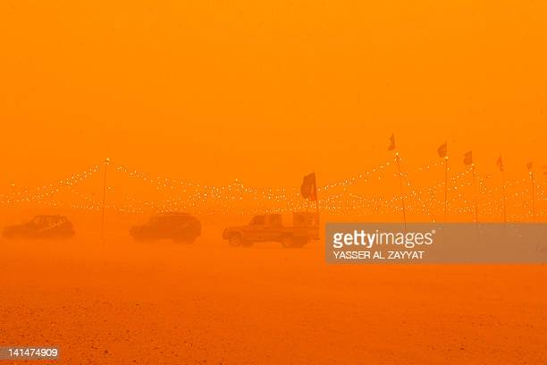 Cars are parked in a camp in Rawdatayn desert 100 Kms North of Kuwait city as a heavy sandstorm hits the country on March 172012 AFP PHOTO/YASSER...