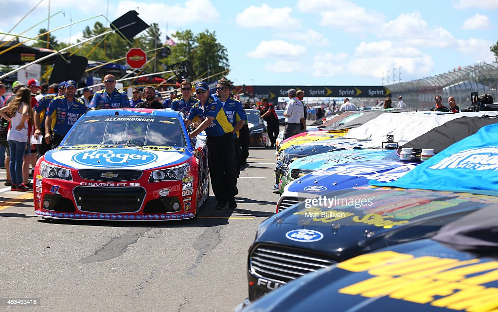 Cars are parked on the grid during the NASCAR Sprint Cup Series CheezIt 355 at the Glen at Watkins Glen International on August 9 2015 in Watkins...