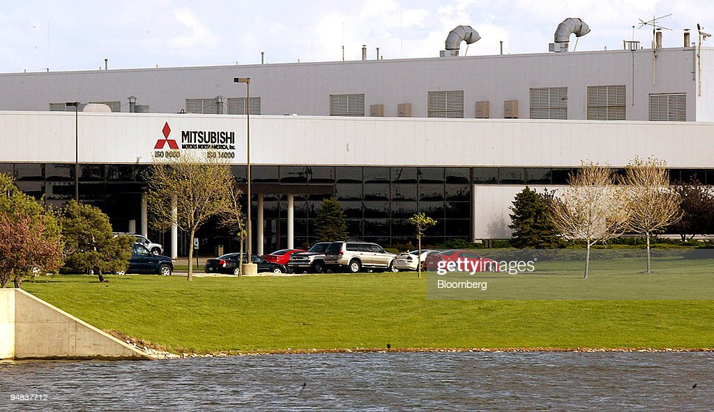 Cars are parked outside of the Mitsubishi Motors plant in Normal Illinois Monday April 26 2004 Japan's only unprofitable automaker will eliminate...