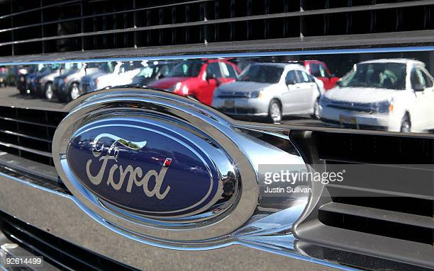 Cars are reflected in the grill of a new Ford truck November 2 2009 in Richmond California Ford Motor rerported a nearly $1 billion third quarter...