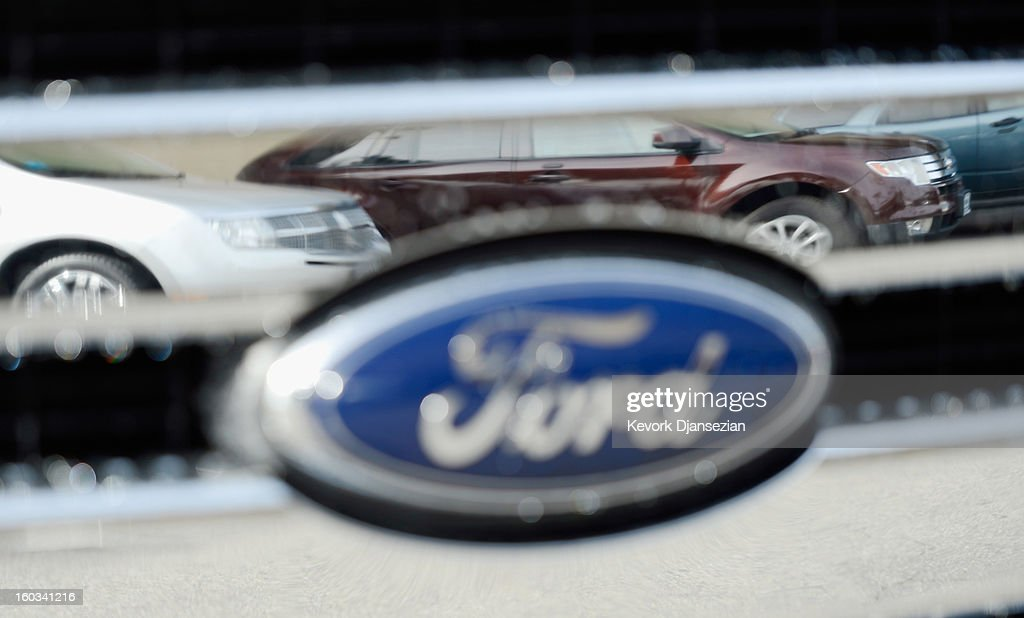 Cars are reflected in the grill of another car at a Ford dealership on January 29, 2013 in Glendale, California. According to reports the nation's second-largest automaker earned $1.7 billion in the fourth-quarter quarter, the highest pre-tax profit in a decade, up 55% from a year earlier. For the year, earnings slipped 5% to $5.7 billion.