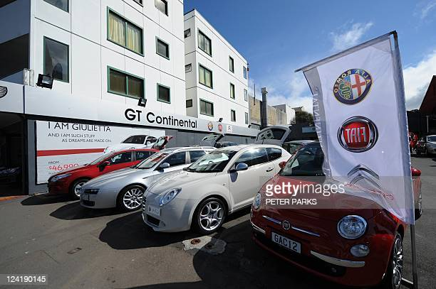 Cars are seen at an Italian motor dealership in Wellington on September 8 2011 AFP PHOTO/Peter PARKS