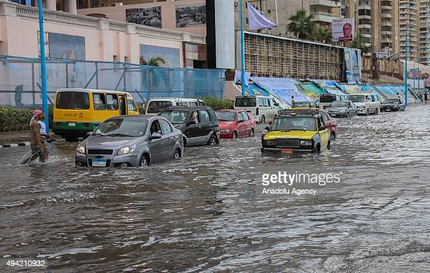 Cars are seen in flood water after a torrential rain caused flood in the Rushdi neigborhood of Alexandria Egypt on October 25 2015