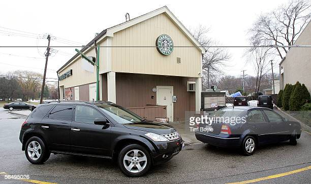 Cars are seen in line outside a Starbucks drivethru December 28 2005 in Wheeling Illinois Starbucks opened 354 drivethru stores in the US in the past...