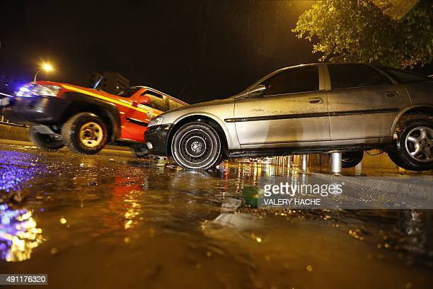 Cars are seen on a flooded street on October 03 2015 in Nice southeastern France AFP PHOTO / VALERY HACHE