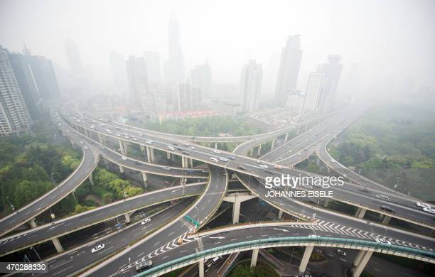 Cars are seen on an elevated road on a heavy polluted day in Shanghai on April 19 2015 AFP PHOTO / JOHANNES EISELE