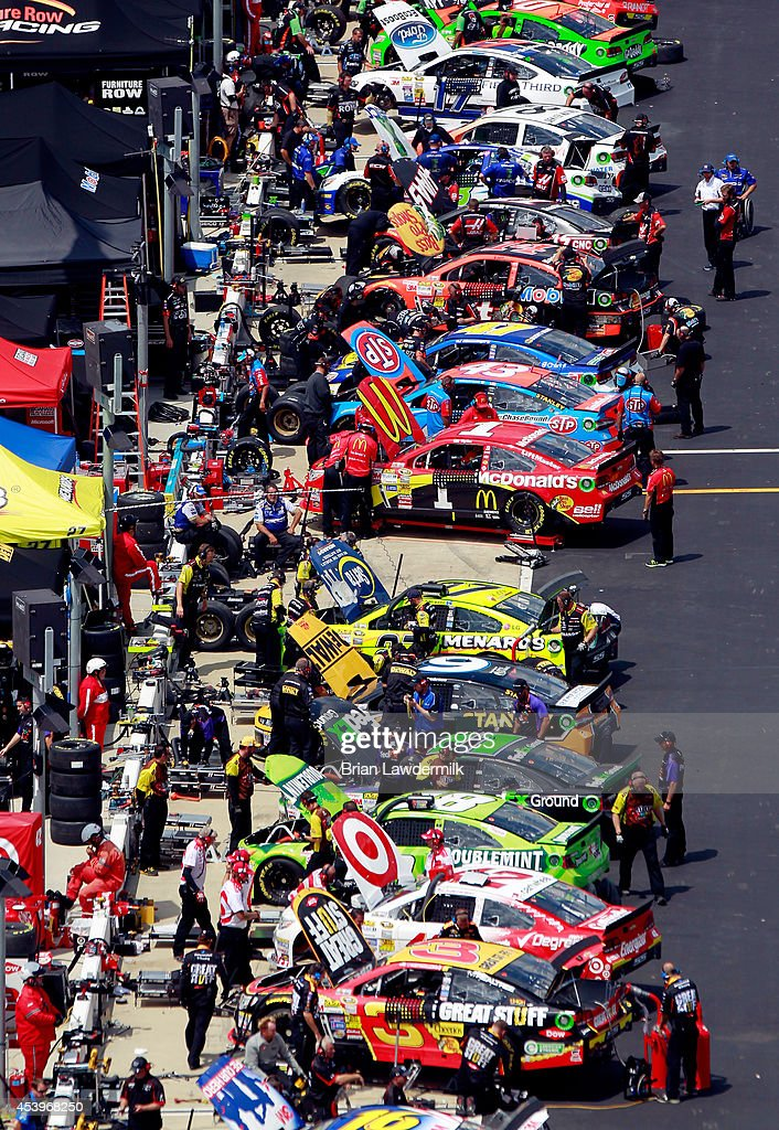 Cars are seen on pit road during practice for the NASCAR Sprint Cup Series Irwin Tools Night Race at Bristol Motor Speedway on August 22, 2014 in Bristol, Tennessee.