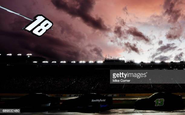 Cars are seen on the grid during a rain delay during the Monster Energy NASCAR Cup Series CocaCola 600 at Charlotte Motor Speedway on May 28 2017 in...