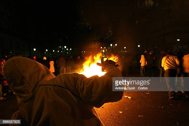 Cars are set alight as confrontations between students and the police contine into the night in Paris after thousands of students demonstrated during...