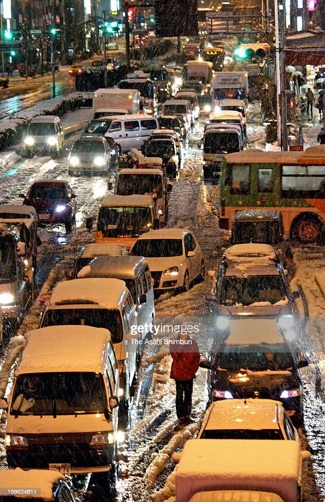 Cars are stuck at a traffic jam in the snow on January 14, 2013 in Tokyo, Japan. A strong low pressure system caused heavy snow and strong wind in the coast area including Tokyo, more than 500 injured.