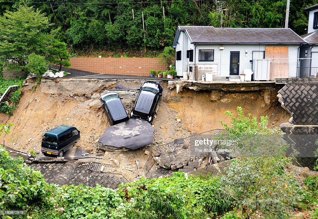 Cars are washed away by a landslide triggered by typhoon Man-Yi approaching on September 16, 2013 in Ikoma, Nara, Japan. The storm hit land near Toyohashi, Aichi Prefecture, before 8 a.m. and moved along Honshu throughout the day, damaging buildings, disrupting transportation and causing blackouts, three killed and five missing.