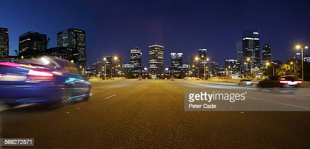 cars at night on highway , city scape Perth .