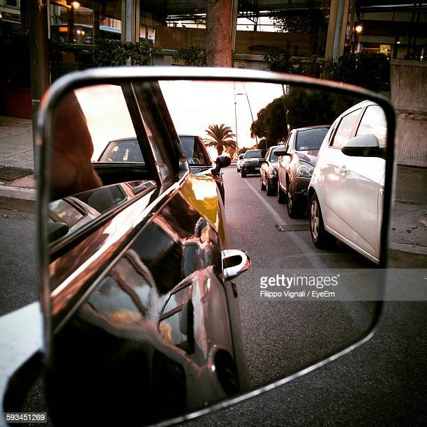 Cars At Road Seen On Side-View Mirror