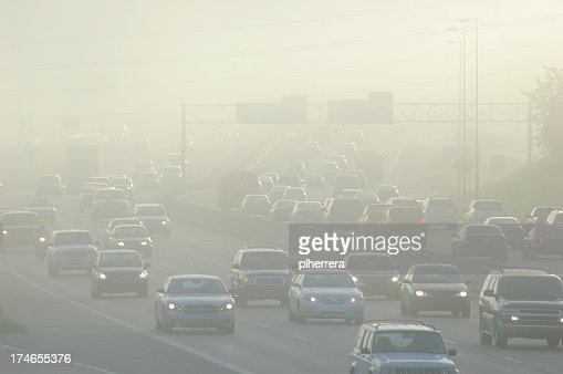 Cars at Rush Hour Driving Through Thick Smog