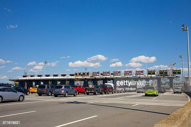 Cars at toll booths of NY bridge