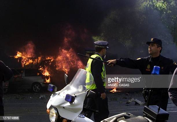 Cars burn after a car bomb exploded in Madrid near Santiago Barnabeu stadium 01 May 2002 in an attack said to be the work of the Basque separatist...