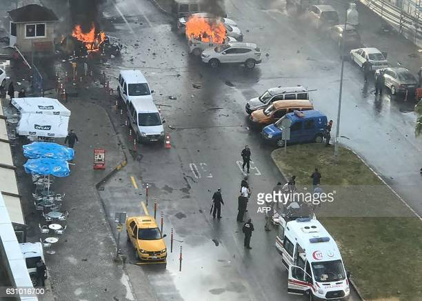 TOPSHOT Cars burn in the street at the site of an explosion in front of the courthouse in Izmir on January 5 2017 A car bomb exploded outside a...