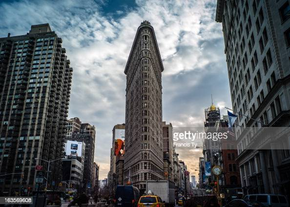 CONTENT] Cars Clouds and the waning sun are captured in this picture of the Flatiron Building in NYC New York