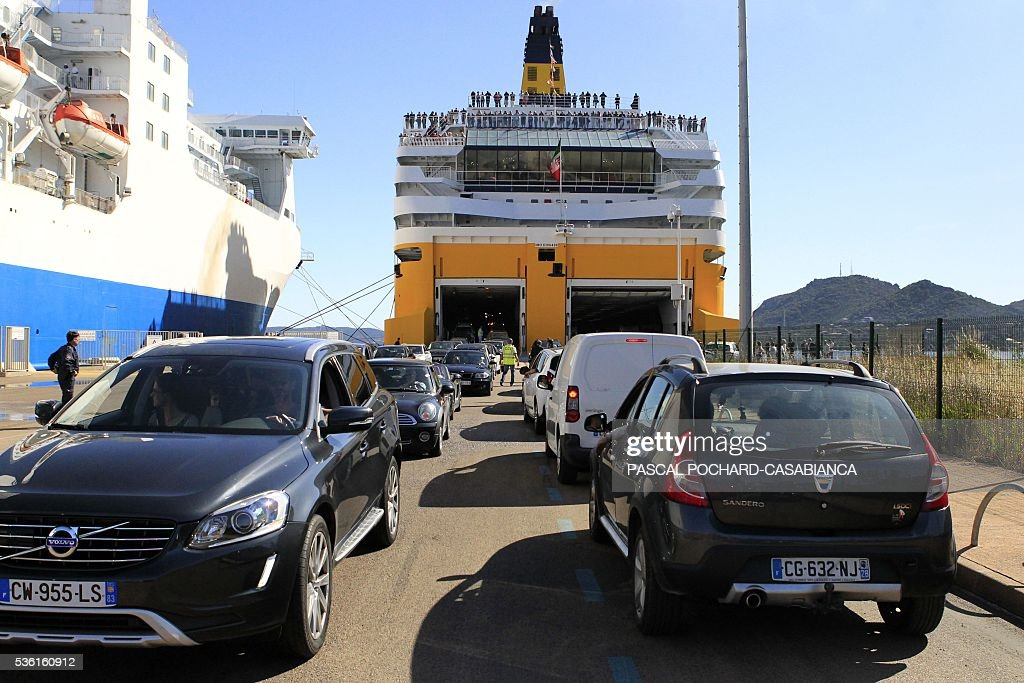 Cars come in and out of the new ferry boat Mega Andrea of the French Corsica Ferries company, on May 31, 2016 in Porto-Vecchio on the French Mediterranean island of Corsica. The Corsica Ferries opened, on May 31, a new line between Nice, Corsica and the island of Sardegna in Italy, reinforcing its position as a leader for the maritime transport between the two neighbour islands Corsica and Sardegna. / AFP / PASCAL