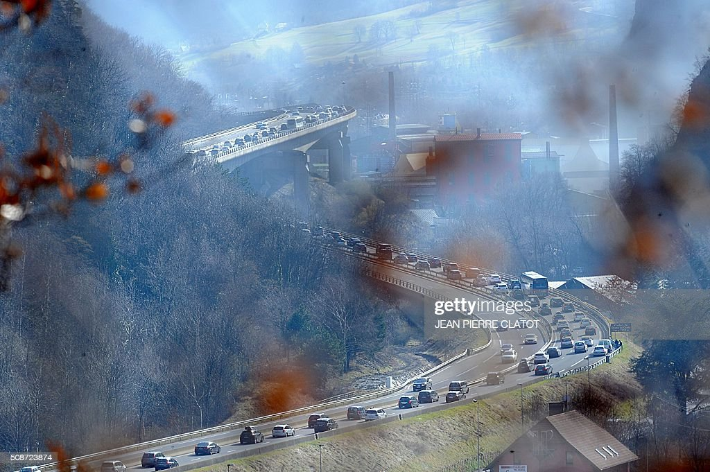 Cars congest on the RN 90 road as people make their way to ski resorts in the French Alps, on February 6, 2016 near Moutiers, central eastern France. CLATOT