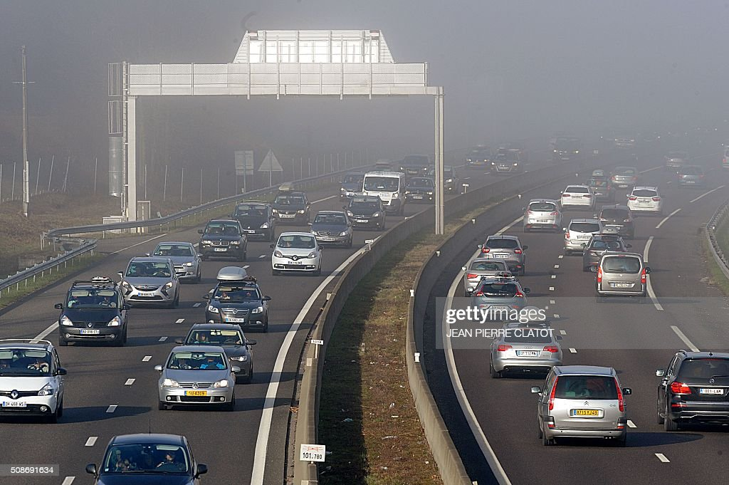 Car congest the A43 highway as people make their way to ski resorts in the French Alps, on February 6, 2016 near Chignin, central eastern France. CLATOT