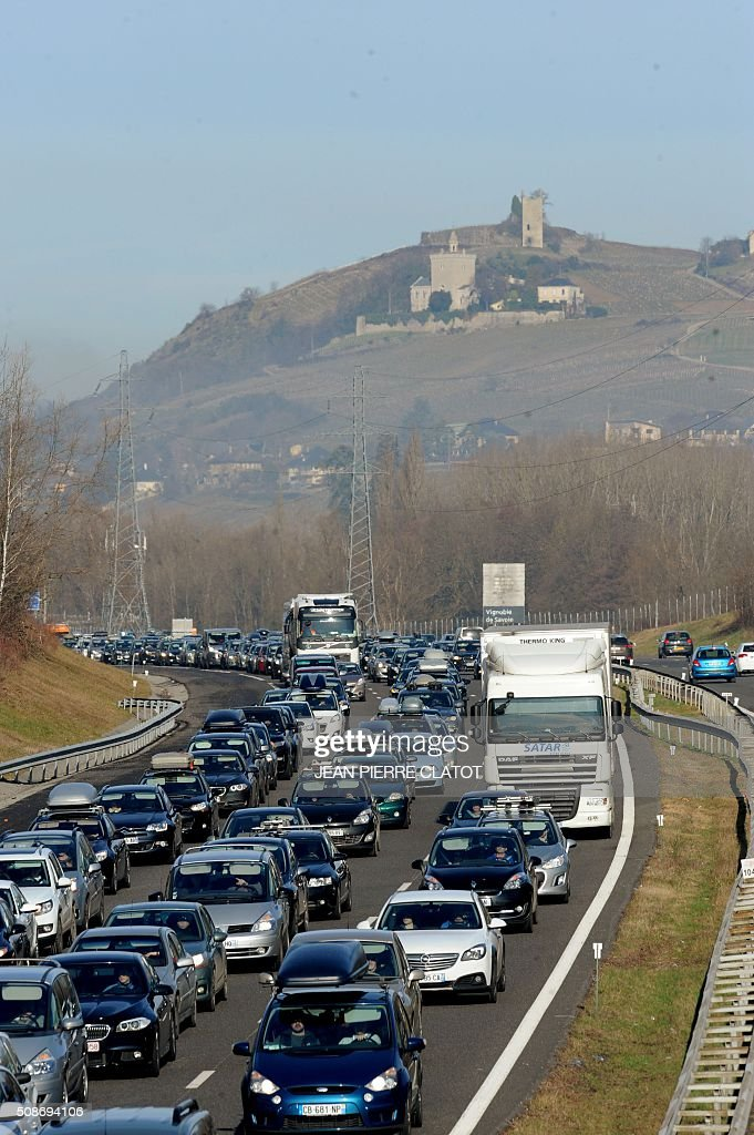 Cars congest the A43 highway as people make their way to ski resorts in the French Alps, on February 6, 2016 near Chignin, central eastern France. CLATOT