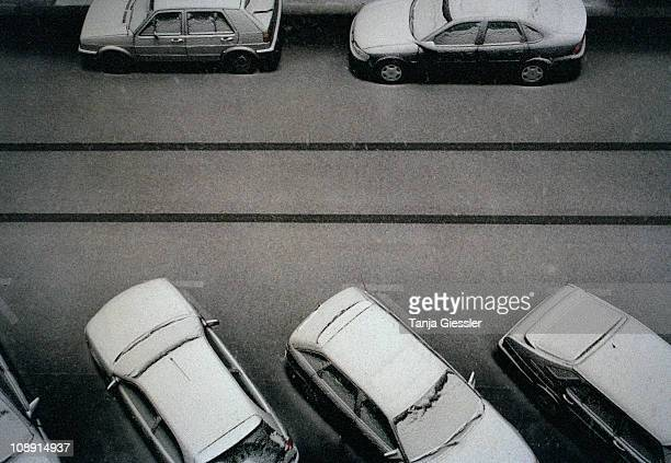 Cars covered in snow on a street