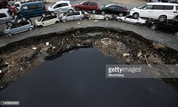 Cars damaged by the tsunami which followed the Great East Japan Earthquake on March 11 are seen stacked on the ground in Ishinomaki City Miyagi...