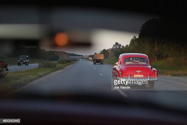 Cars drive along a highway on February 24 2015 in Havana Cuba The recent thaw in USCuba relations has increased the number of American visitors to...