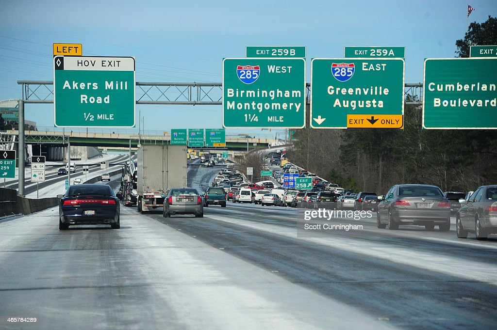 Cars drive along Interstate 75 in icy conditions January 29, 2014 in Atlanta, Georgia. Thousands of motorists were stranded, many overnight, as a winter storm dropped three inches of snow, and ice made driving hazardous.