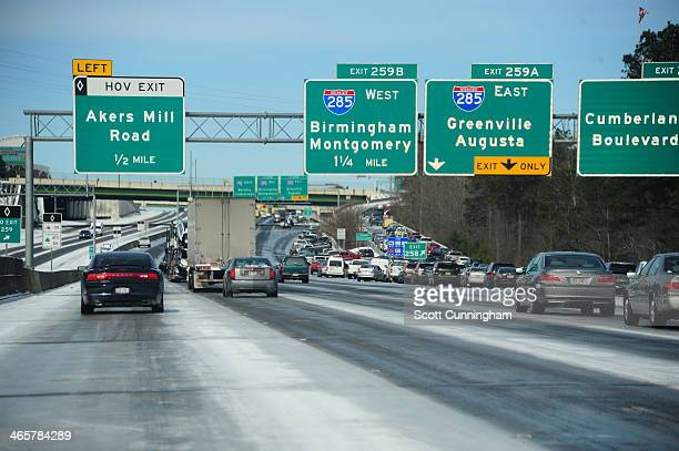 Cars drive along Interstate 75 in icy conditions January 29 2014 in Atlanta Georgia Thousands of motorists were stranded many overnight as a winter...