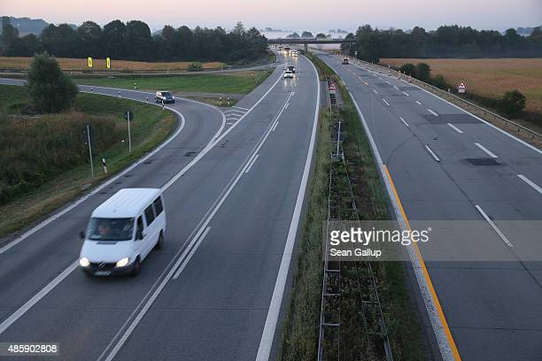 Cars drive along the A3 highway near the border to Austria on a section used daily by arriving migrants on August 30 2015 near Neuhaus am Inn Germany...