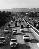 Cars drive along the Hollywood freeway in Cahuenga Pass circa 1940s