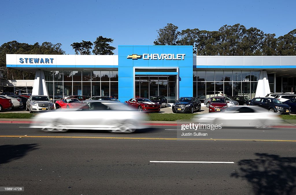 Cars drive by a Chevrolet dealership on January 3, 2013 in Colma, California. Chrylser and General Motors led automakers in the best sales year since 2007. Chrysler's December sales jumped 10% while GM's was up 4.9%.