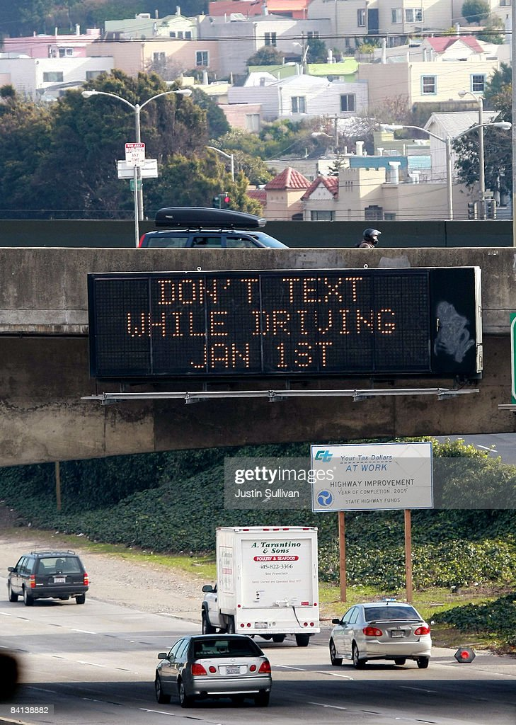 Cars drive by a sign notifying of a new texting while driving law on Interstate 280 December 29, 2008 in San Francisco, California. A new law making it illegal to send text messages while driving will begin on January 1, 2009.