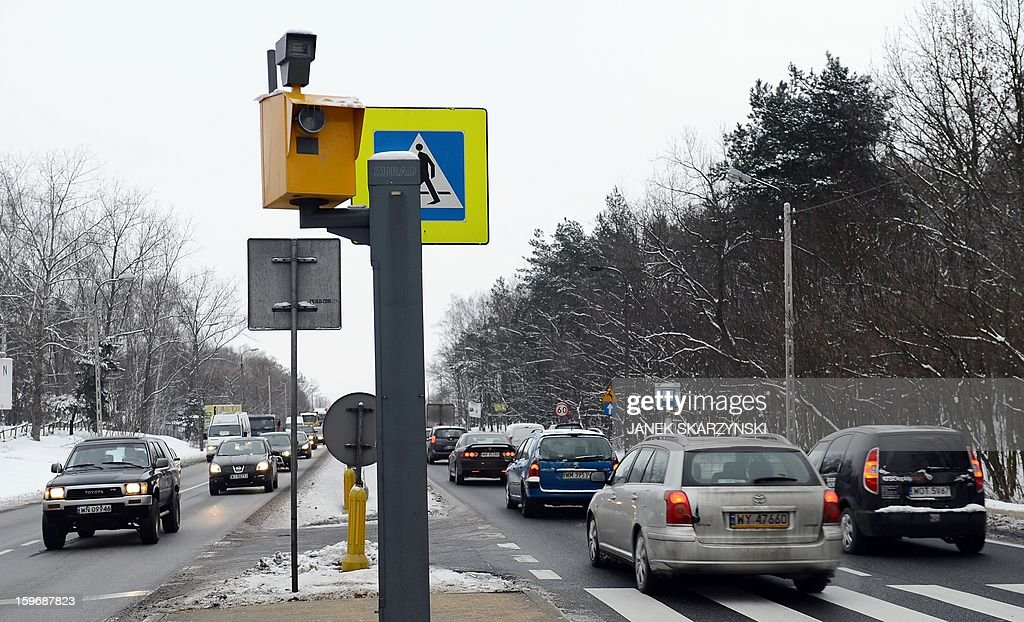 Cars drive by a traffic radar on the outskirts of the Polish capital Warsaw on January 17, 2013. With Poland's roads being the deadliest in the European Union, authorities are dramatically boosting the number of radars monitoring motorists. The move has drawn the ire of Poles, concerned they will have to pay more traffic fines.