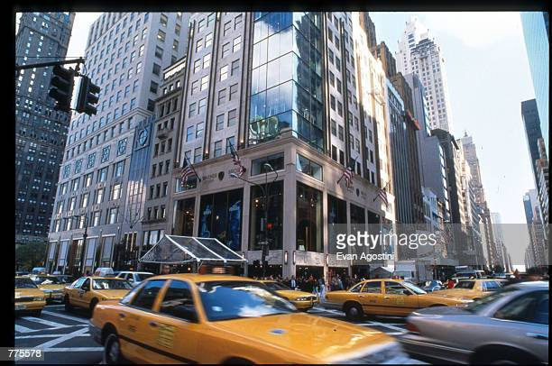Cars drive by the Warner Bros Studio store October 23 1996 in New York City The store originally a three floor specialty store has been redesigned...