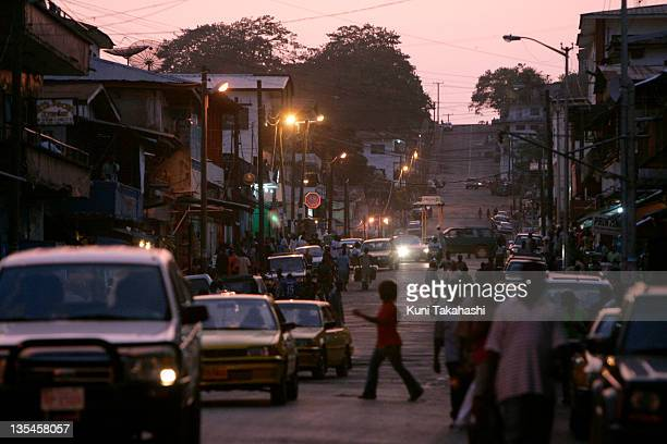 Cars drive down a street May 14 2008 in the city center of Monrovia Liberia Despite President Ellen JohnsonSirleaf's effort to reduce corruption...
