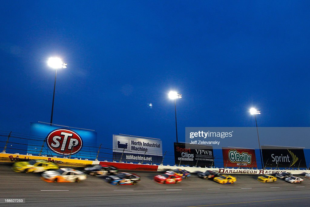 Cars drive down the backstretech during the NASCAR Nationwide Series VFW Sport Clips Help A Hero 200 at Darlington Raceway on May 10, 2013 in Darlington, South Carolina.