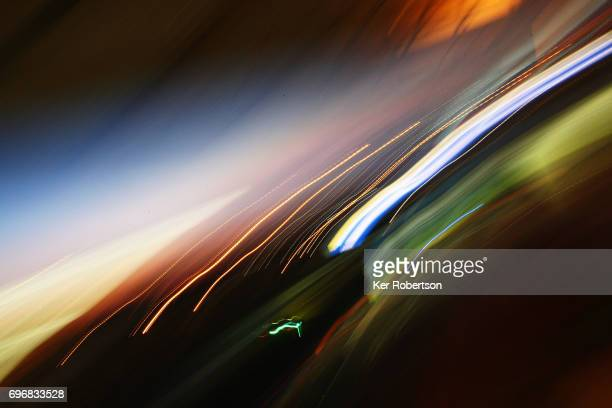 Cars drive down the main straight during qualifying for the Le Mans 24 Hours race at the Circuit de la Sarthe on June 15 2017 in Le Mans France