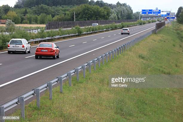 Cars drive down the motorway towards Serbia on July 16 2016 in Roszke Hungary Last summer thousands of refugees and migrants were using the socalled...