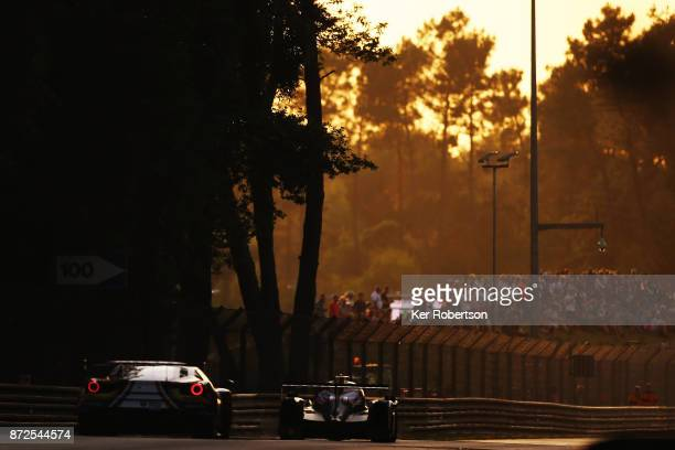 Cars drive into Indianapolis corner during qualifying for the Le Mans 24 Hours race at the Circuit de la Sarthe on June 15 2017 in Le Mans France