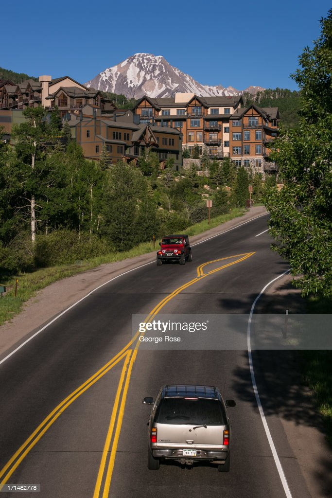 Cars drive into this ski village and resort community on June 14 in Snowmass Colorado Colorado's Rocky Mountains are part of a range that extends...