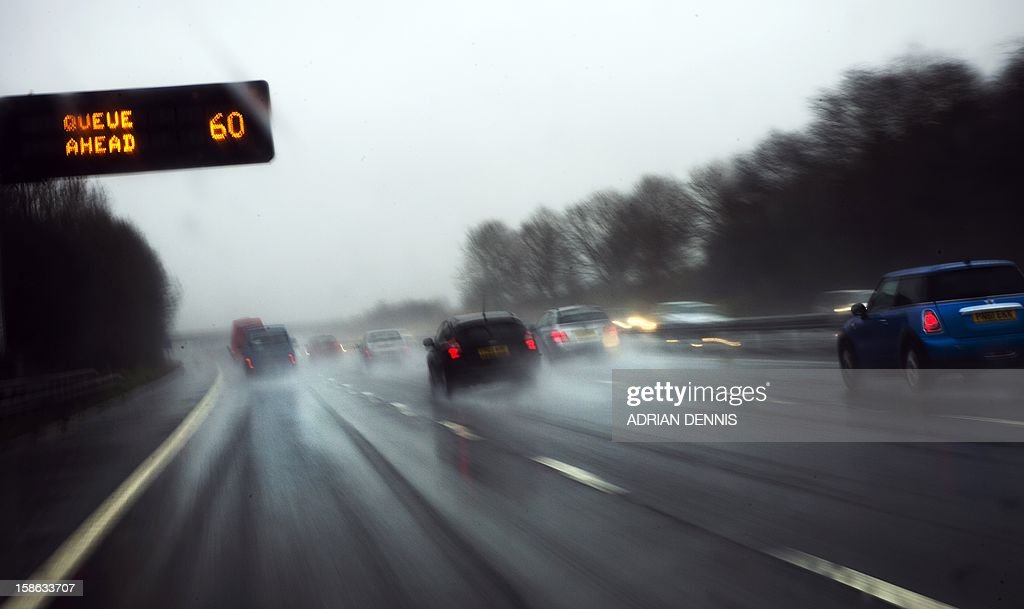 Cars drive northbound on the M6 motorway near Knutsford on December 22, 2012 during heavy rainfall. Heavy rain across Britain has lead to travel disruption and flooding, with the Enviroment Agency raising upwards of 120 flood warnings, three of which were severe.
