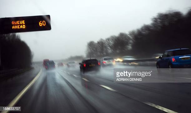 Cars drive northbound on the M6 motorway near Knutsford on December 22 2012 during heavy rainfall Heavy rain across Britain has lead to travel...
