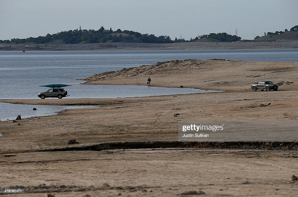 Cars drive on a dry section of Folsom Lake on March 20, 2014 in Granite Bay, California. Now in its third straight year of drought conditions, California is experiencing its driest year on record, dating back 119 years, and reservoirs throughout the state have low water levels. Folsom Lake, a reservoir located northeast of Sacramento, has seen its capacity dwindle over the past 2-1/2 years of drought with current levels at around 20% of normal.
