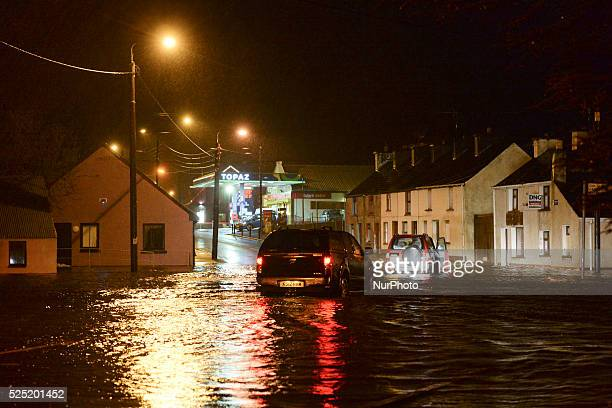 Cars drive on a flooded road Castlefynn as the storm Desmond hit West and North of Ireland with heavy rain and strong winds causing roads chaos...