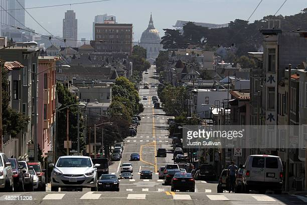 Cars drive on Fulton Street on July 28 2015 in San Francisco California According to a report by TRIP a Washington DC based national transportation...